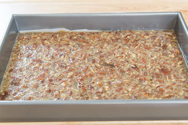 Maple Pecan Bar Filling In 9x13 Metal Cake Pan Ready To Be Baked
