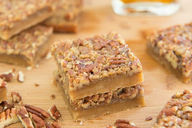 Cut Maple Nut Bars Stacked On Top Of Each Other On Wooden Cutting Board