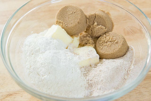 Glass Duralex Mixing Bowl With All Purpose Flour, Whole Wheat Flour, Softened Butter, and Pucks Of Light Brown Sugar