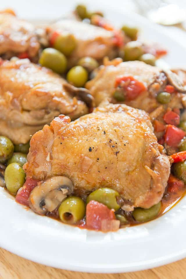 Chicken Cacciatore - On a White Platter with Olives and Mushrooms