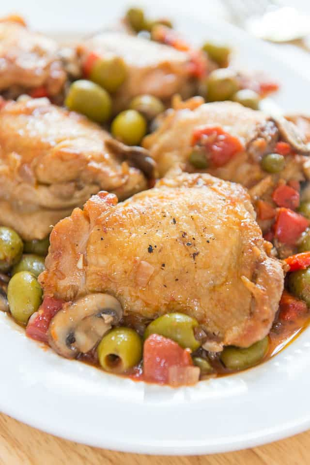 This Chicken Cacciatore is a delicious and healthy one-pot meal, with braised chicken thighs, mushrooms, bell peppers, tomatoes, onion, and green olives.