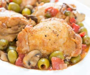 Bone-In Skin-On Chicken Thigh Cacciatore With Green Olives On White Crate & Barrel Dotted China Platter