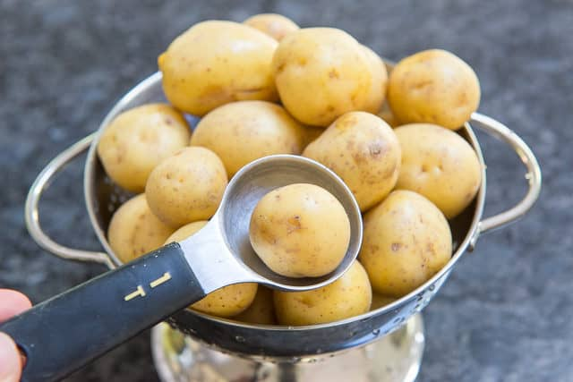 Baby Yellow Potatoes in Colander and Tablespoon
