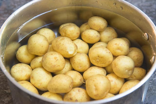 Baby Creamer Potatoes Covered In Cold Water In Saucepan