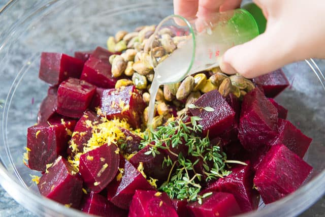 Pouring Lemon Juice on the Oven Roasted Beets