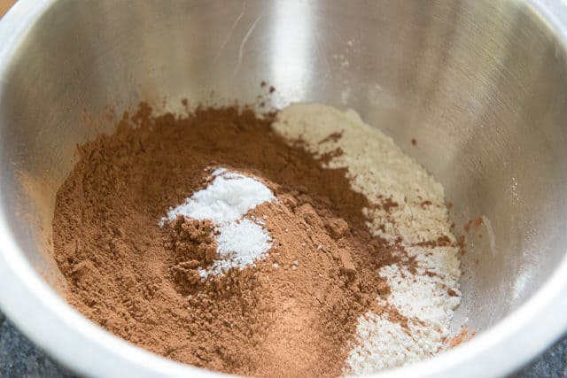 Flour, Sifted Cocoa Powder, Baking Soda, and Salt in Stainless Steel OXO Mixing Bowl