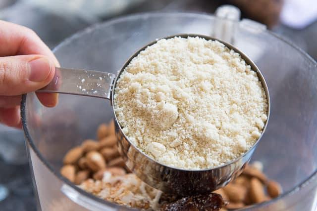 Adding Almond Flour to Food Processor Bowl