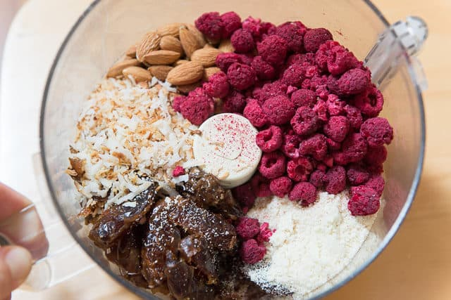Freeze Dried Raspberries, Medjool Dates, Toasted Coconut, Blanched Almond Flour, Raw Almonds, Vanilla Extract, and Coconut Oil in Food Processor