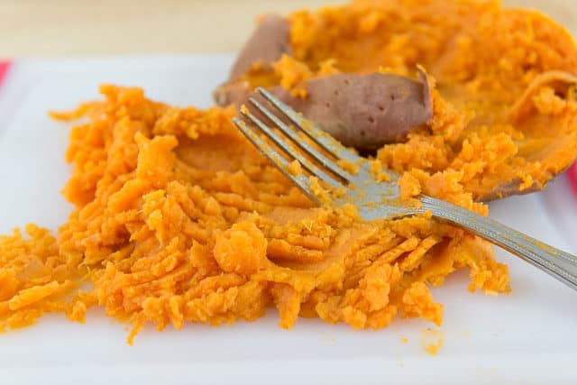 Mashed Sweet Potatoes with Fork on Board