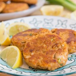 Salmon Patties - On a Blue Plate with Fresh Lemon Wedges