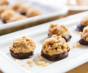 Chocolate Peanut Butter Bon Bons On a Rectangle Dotted White Platter