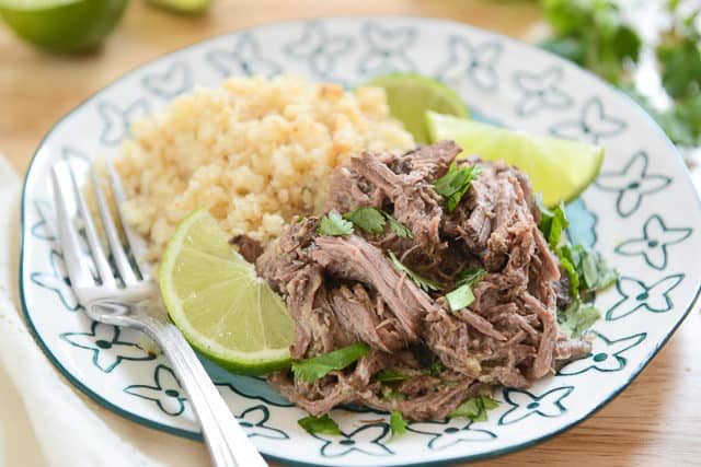 Indian Shredded Slow Cooked Beef With Fresh Lime, Cauliflower Rice, and Cilantro on Plate