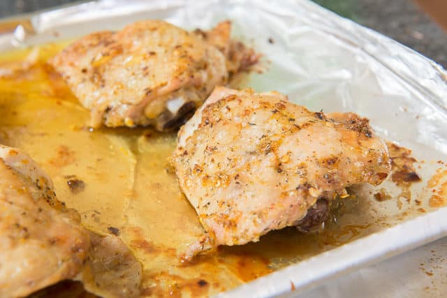 Garlic and Citrus Rubbed Chicken Thighs On Foil Lined Tray