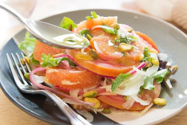Sliced Cara Cara Orange Segments, Chioggia Beets, Pickled Red Onions, Shaved Fennel Salad with Spoon Drizzling Citrus Vinaigrette