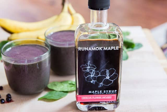 Runamok Maple Hibiscus Syrup Bottle On Cutting Board With Smoothie Ingredients