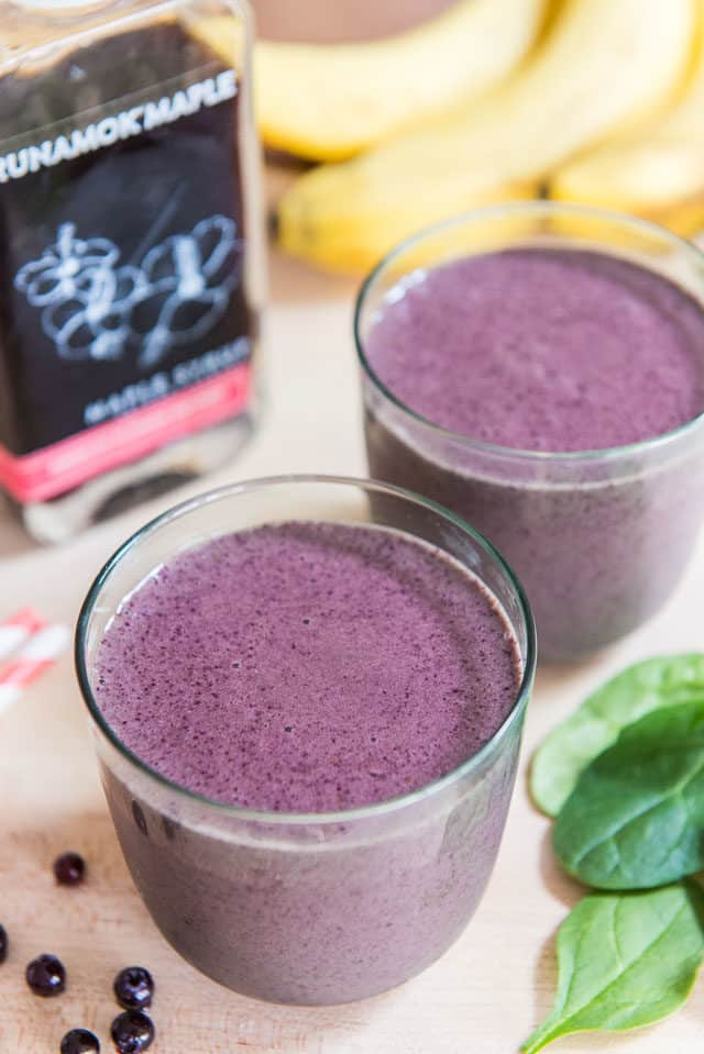 Blueberry and Banana Smoothie - In Two Glasses on Wooden Board