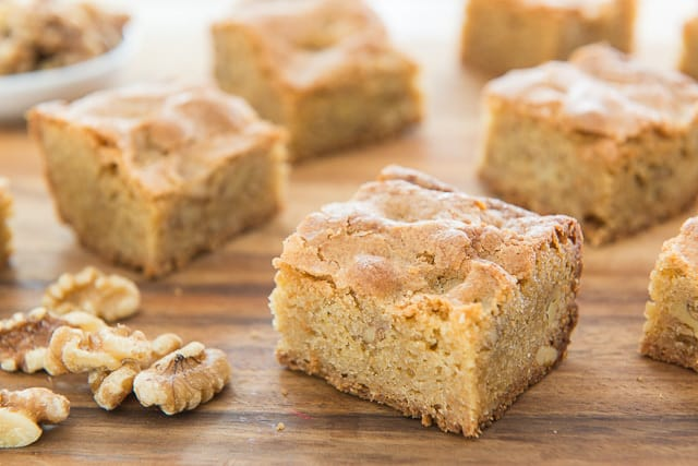 Brown Butter Blondies On Cutting Board With Walnuts