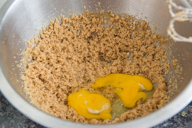 Brown butter, sugar, and eggs in mixing bowl for blondies
