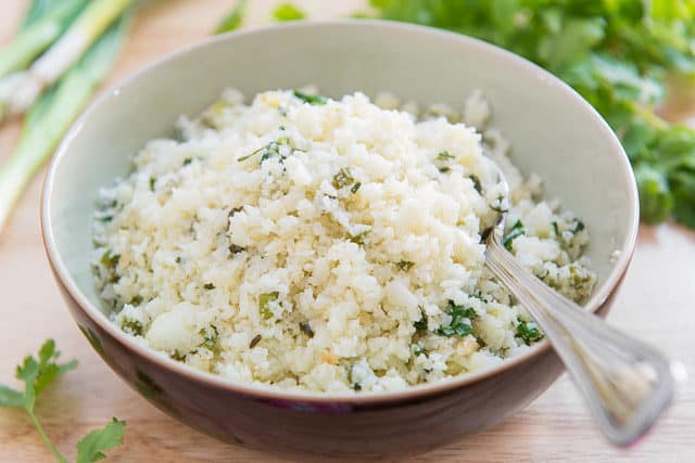 Cauliflower Rice in Bowl with Cilantro and Lime Juice