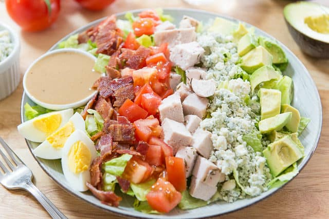 California Cobb Salad In Rows On Blue Plate