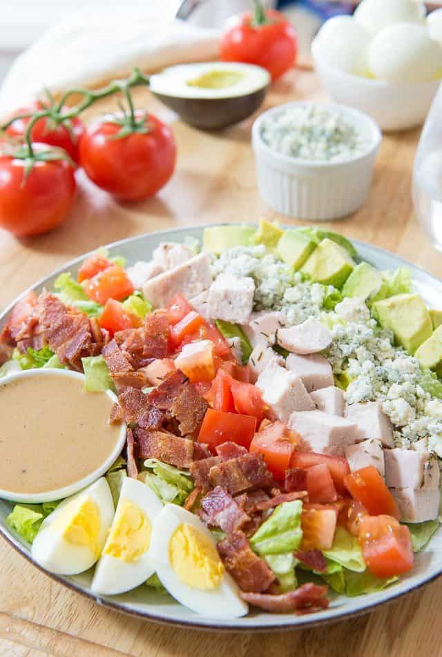 Bacon, Hardboiled Eggs, Chicken, Tomatoes, Blue Cheese, Avocado on Lettuce for Cobb Salad