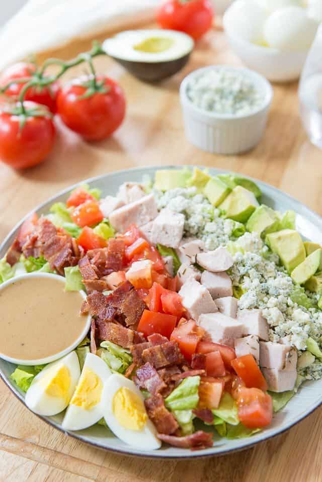 California Cobb Salad with Homemade Dressing, Vine Ripened Tomatoes, Blue Cheese Crumbles,and Avocado