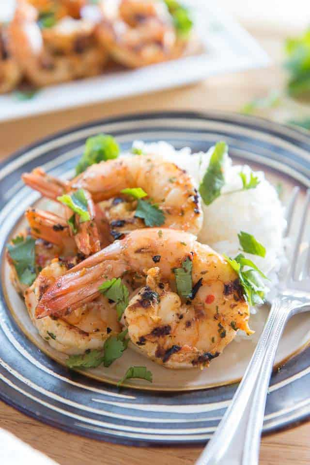 This Chipotle Shrimp has SO much flavor and cooks up in a flash! Peeled shrimp are quickly marinated in a fresh cilantro chipotle mixture, then cooked on the grill for a charred flavor. You can also sear the shrimp in a hot skillet.