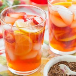 Strawberry Iced Tea In a Glass with Fruit and Strawberry Syrup