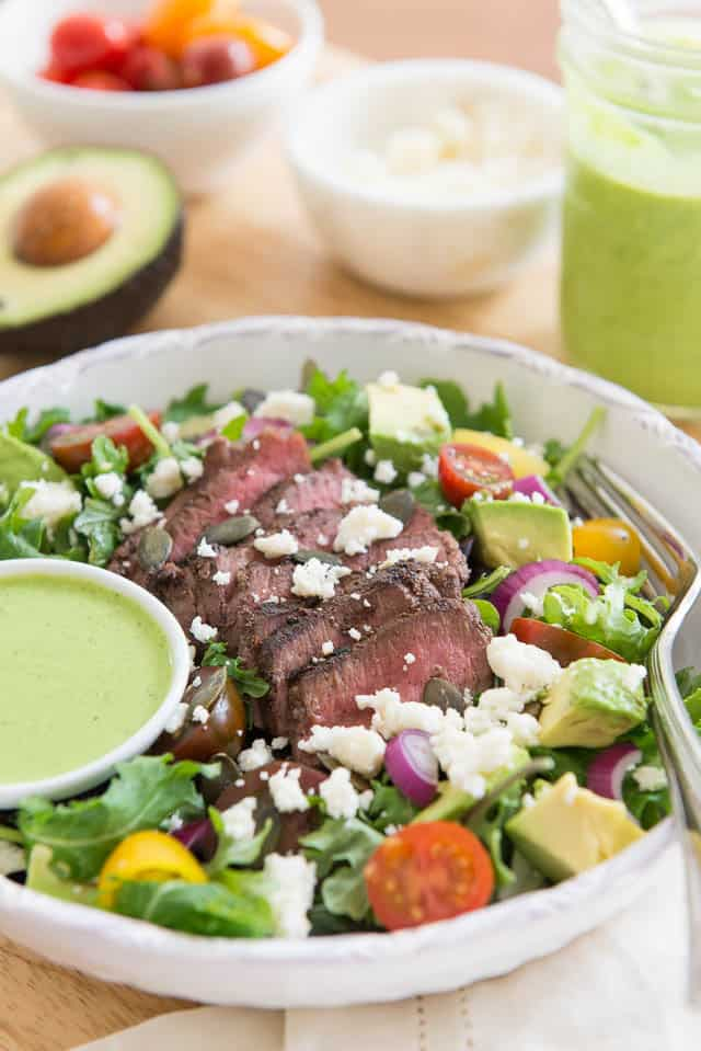 This Steak Salad is hearty enough to serve as the full meal for lunch or dinner, and has tons of flavor. Steak is pan seared and sliced thinly, then paired with ingredients like queso fresco, avocado, tomatoes, and a fresh Cilantro Lime Dressing.