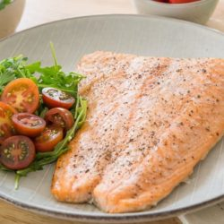 Baked Salmon On a Plate with Tomatoes and Salad
