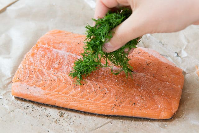Oven Baked Salmon - Adding fresh dill to salmon fillet