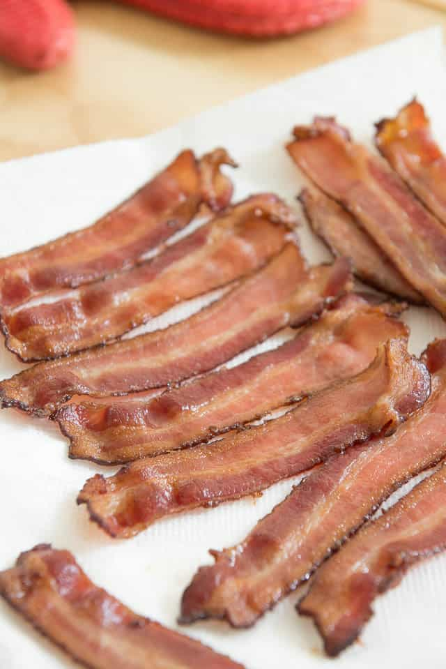 Bacon cooked in the oven results in much crispier, evenly cooked bacon. Plus, you can do a big batch at one time instead of having to do many batches in a frying pan.