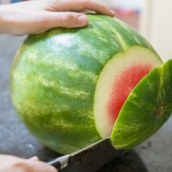 Cutting the End off a Fresh Watermelon