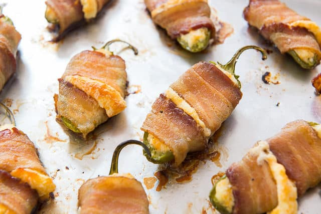 Bacon Wrapped Stuffed Jalapeños - On a Sheet Pan with Cheese Oozing Out