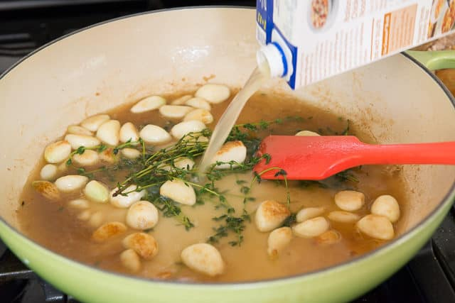 Pouring In Chicken Stock to the Pan