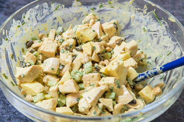 Curry Chicken Salad with Apples in Mixing Bowl with Spatula