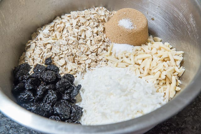 Oats, Cherries, Brown Sugar, Coconut, Salt, and Nuts in a Mixing Bowl