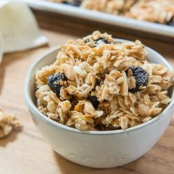 Granola Recipe Served In a Gray Bowl on Wooden Board with napkin
