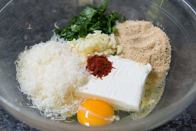 Cream Cheese, Egg, Grated Cheese, Bread Crumb, Spices, and Herbs in Mixing Bowl