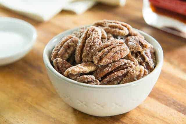 Maple Glazed Pecan Nuts in Gray Bowl on Wooden Board