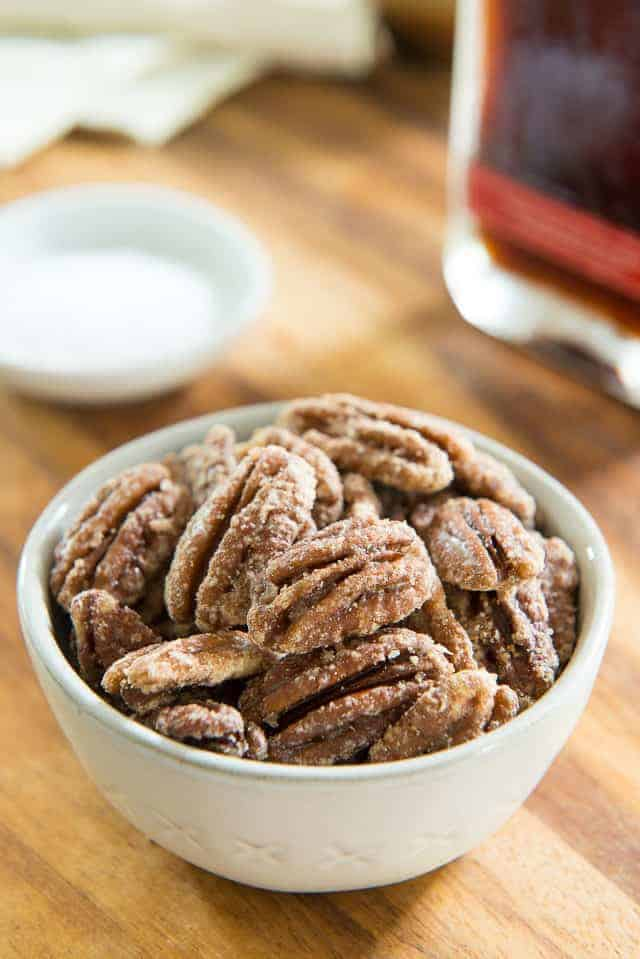 Maple Pecan Nuts in Gray Bowl on Wooden Board