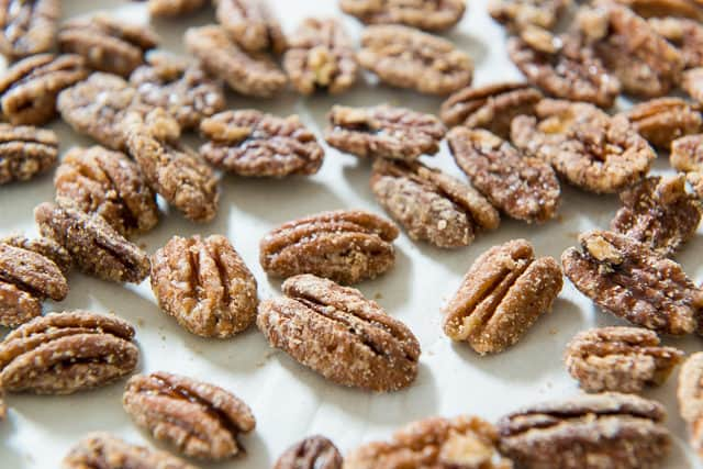 Maple Covered Pecans On Parchment Resting