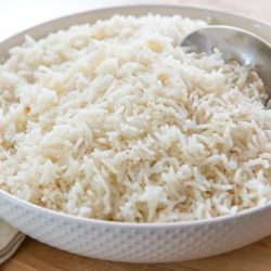 A bowl of rice pilaf with spoon