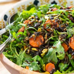 Wild Rice Salad In Bowl with Carrots and Pistachios