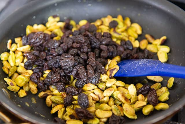 Raisins Added to Pistachios In Skillet