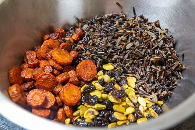 Cold Wild Rice Salad - In a Bowl with Pistachios, Raisins, and Carrots