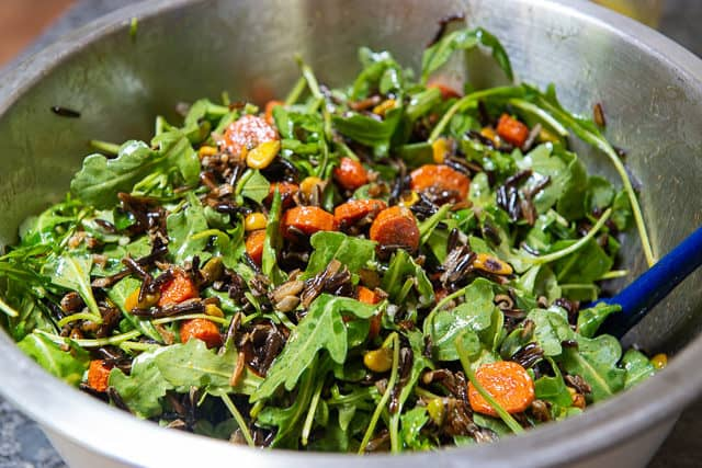 Arugula Tossed with Carrots, Wild Rice, and Raisins