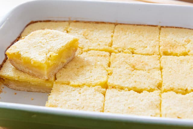 Homemade Lemon Bars - Freshly Baked in a Green Casserole Dish and Cut Into Squares