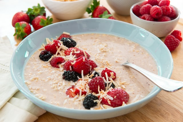 Healthy Overnight Oats - Pictured in Low Blue Bowl with Spoon as Dairy Free Option