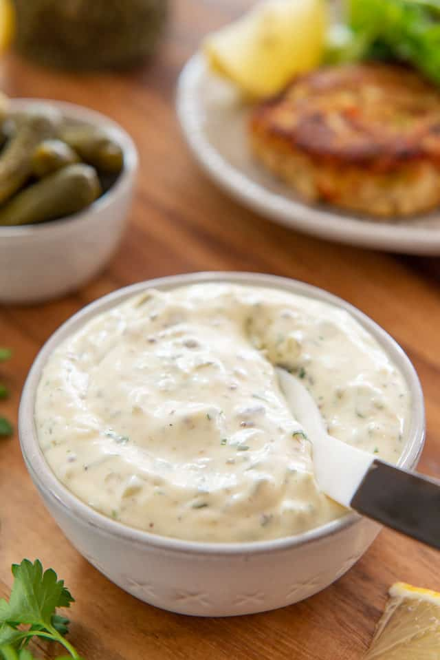 Tartar Sauce - In a white Bowl with Spoon on Wooden Board